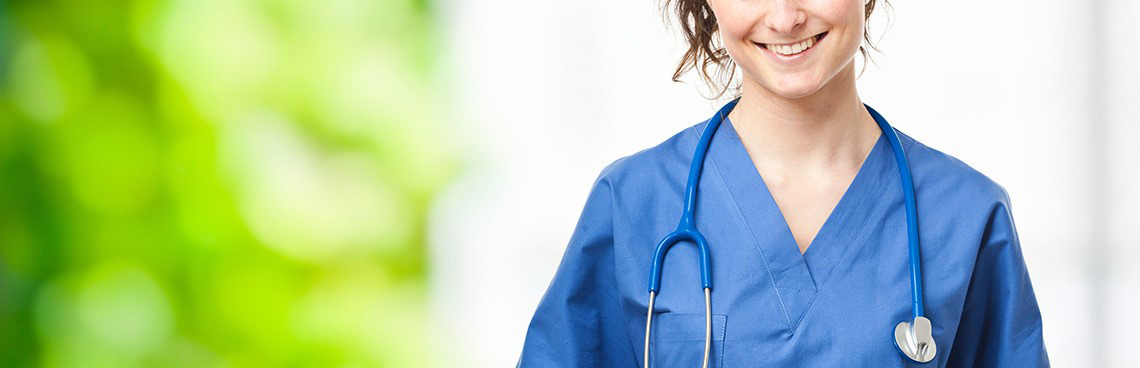 Nurse smiling with stethoscope around neck.